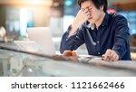 young asian business man... | Shutterstock . vector #1121662466