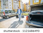 young adult man putting bag in...   Shutterstock . vector #1121686493