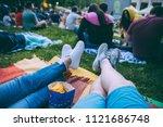 people watching movie in open... | Shutterstock . vector #1121686748