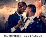 gay couple dancing on wedding... | Shutterstock . vector #1121716106