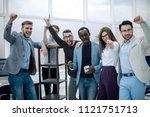 friendly business team in the... | Shutterstock . vector #1121751713