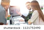 business team discussing... | Shutterstock . vector #1121752490