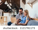 beautiful couple sitting on the ... | Shutterstock . vector #1121781173