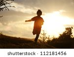 Kid Running On Meadow Silhouette
