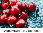 ripe cherries close up  on a... | Shutterstock . vector #1121823080