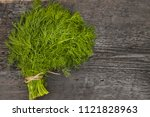 parsley bunch on wooden table... | Shutterstock . vector #1121828963