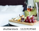 Stock photo glass of rose wine and cheese board in a hotel room selective focus 1121919560