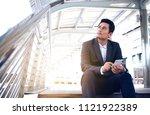 business man sit on upstair... | Shutterstock . vector #1121922389