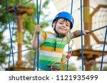 boy having fun at adventure... | Shutterstock . vector #1121935499