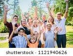 portrait of happy foster family ... | Shutterstock . vector #1121940626