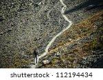 Man Walking On Mountain Trail ...