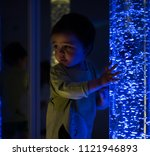 young kid exploring a multi... | Shutterstock . vector #1121946893