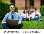 male university student sitting ... | Shutterstock . vector #1121950820