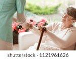 doctor helping an elderly woman ... | Shutterstock . vector #1121961626