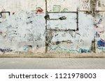 grunge graffiti painted wall... | Shutterstock . vector #1121978003