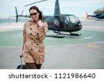 business woman near private... | Shutterstock . vector #1121986640