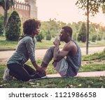 black couple doing exercise... | Shutterstock . vector #1121986658