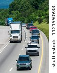 line of mixed traffic travels i ... | Shutterstock . vector #1121990933
