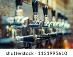 valves for filling beer bottles | Shutterstock . vector #1121995610