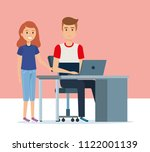 young couple in the workplace... | Shutterstock .eps vector #1122001139