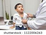 pediatrician is diagnosing... | Shutterstock . vector #1122006263