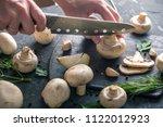 women's hands are cutting...   Shutterstock . vector #1122012923