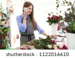 young florist working with... | Shutterstock . vector #1122016610
