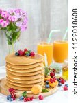 fresh delicious pancakes with... | Shutterstock . vector #1122018608