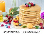 fresh delicious pancakes with... | Shutterstock . vector #1122018614