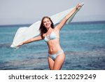 cheerful woman in bikini at... | Shutterstock . vector #1122029249