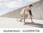 athletic slender girl runner... | Shutterstock . vector #1122094736