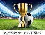 golden winner s cup in the... | Shutterstock . vector #1122125849