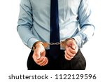 the man in handcuffs ... | Shutterstock . vector #1122129596