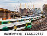 trains on the tracks and power... | Shutterstock . vector #1122130556