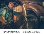 American Caucasian Rancher Resting in the Barn. Countryside Theme. Cowboy and the Country. - stock photo
