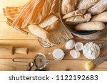 male baker prepares bread. male ... | Shutterstock . vector #1122192683