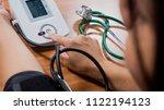woman measuring arterial blood... | Shutterstock . vector #1122194123