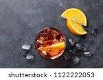 negroni cocktail on dark stone...   Shutterstock . vector #1122222053