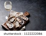 opened oysters  ice on board... | Shutterstock . vector #1122222086