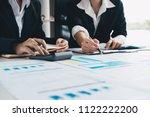 asian business adviser meeting... | Shutterstock . vector #1122222200