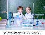 two children scientists making... | Shutterstock . vector #1122234470