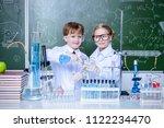 two children scientists making... | Shutterstock . vector #1122234470