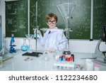 clever schoolboy stands by a... | Shutterstock . vector #1122234680