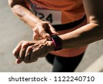 senior runner using a fitness... | Shutterstock . vector #1122240710