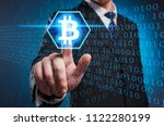 bitcoin. a man in a suit and... | Shutterstock . vector #1122280199