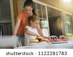 mother and daughter preparing... | Shutterstock . vector #1122281783