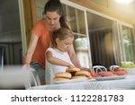 mother and daughter preparing... | Shutterstock . vector #1122281783