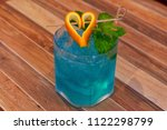 blue cocktail was decorated by... | Shutterstock . vector #1122298799