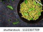 fusilli pasta with  pesto sauce ... | Shutterstock . vector #1122307709