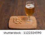 a glass of lager beer with... | Shutterstock . vector #1122324590